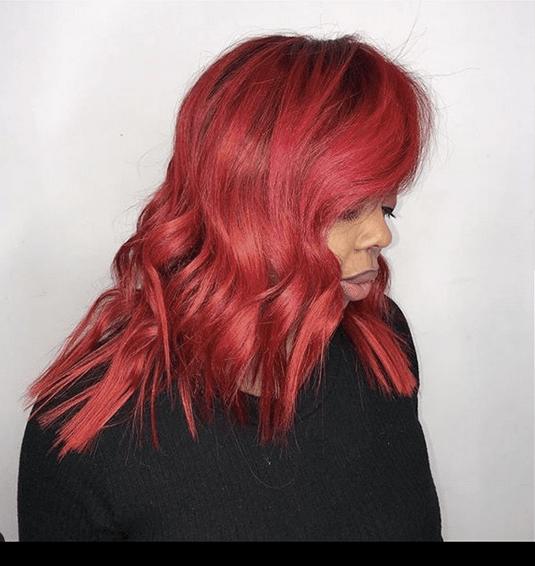 Bright Red Choppy Layered Hair