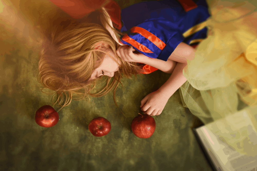 fairy tale princess with book and apples