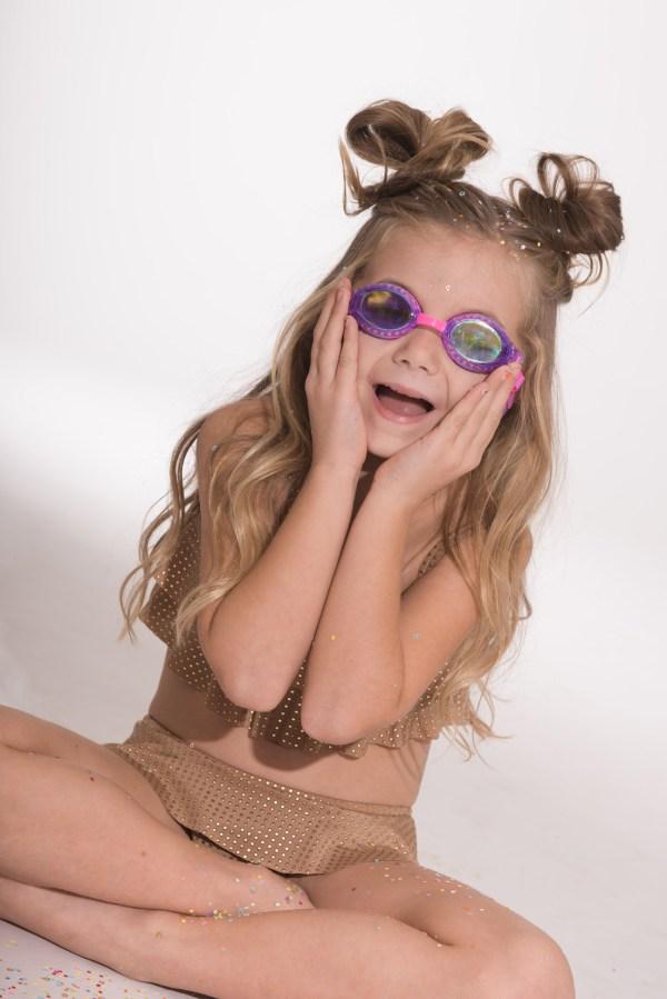 Purple swimming goggles