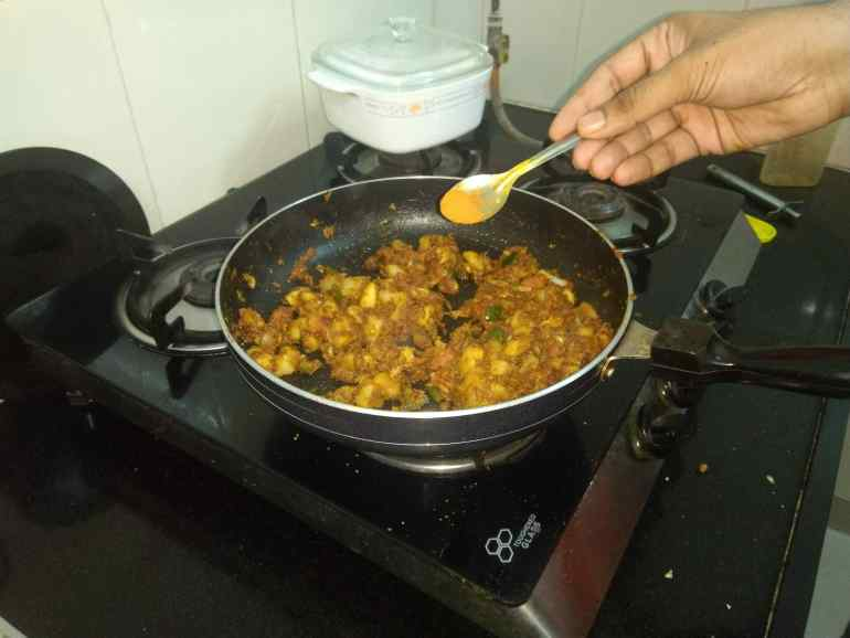 Pav Bhaji Masala to the Cooking Spiced Vegetables