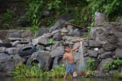 Little boy plays fisherman