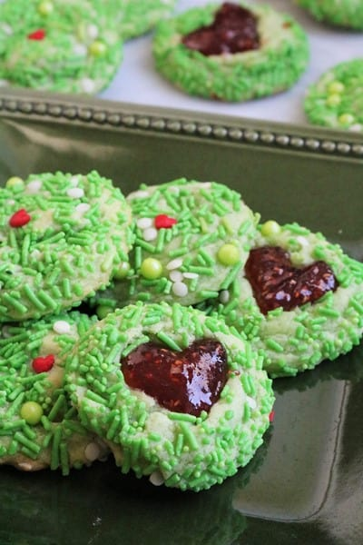 Green Grinch with Red Jam Heart Thumbprint Cookies
