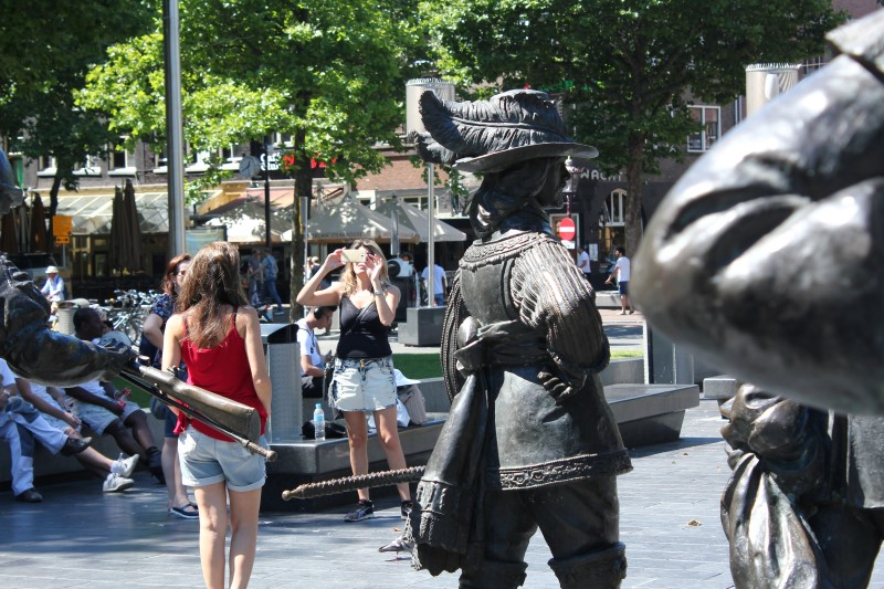 Tourists enjoy a sculpture of the Night Watch at Rembrandt Square