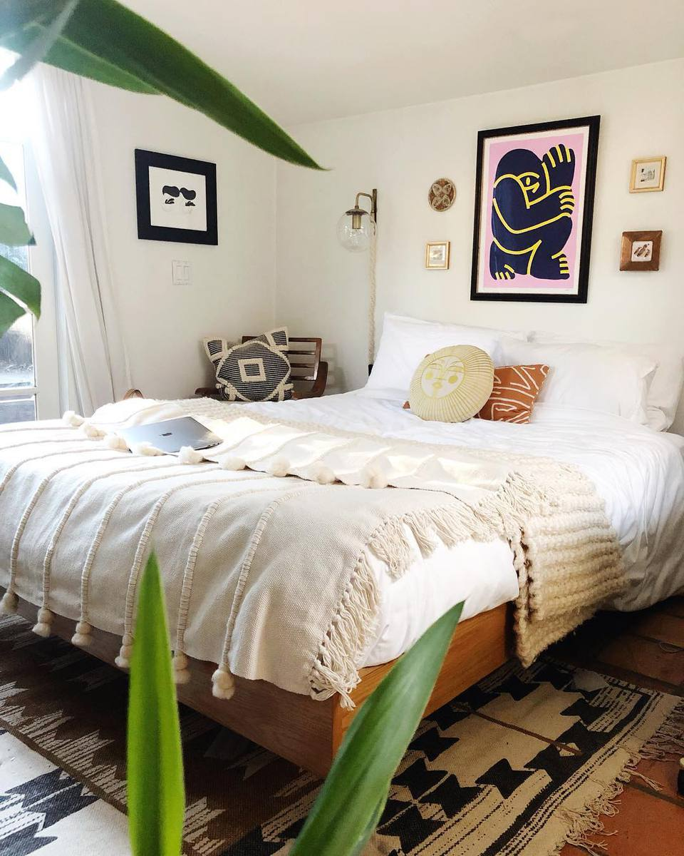 Bedroom with a large picture over the bed