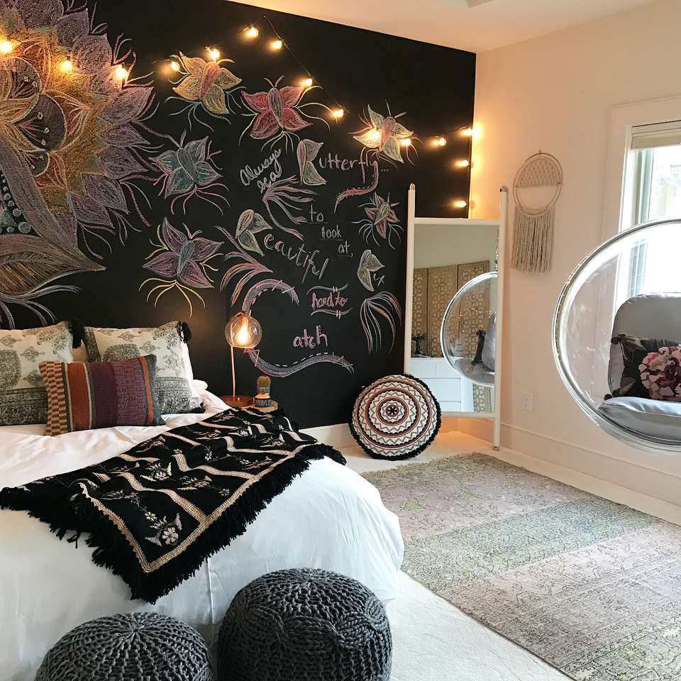 Bedroom with a large chalkboard wall behind the bed