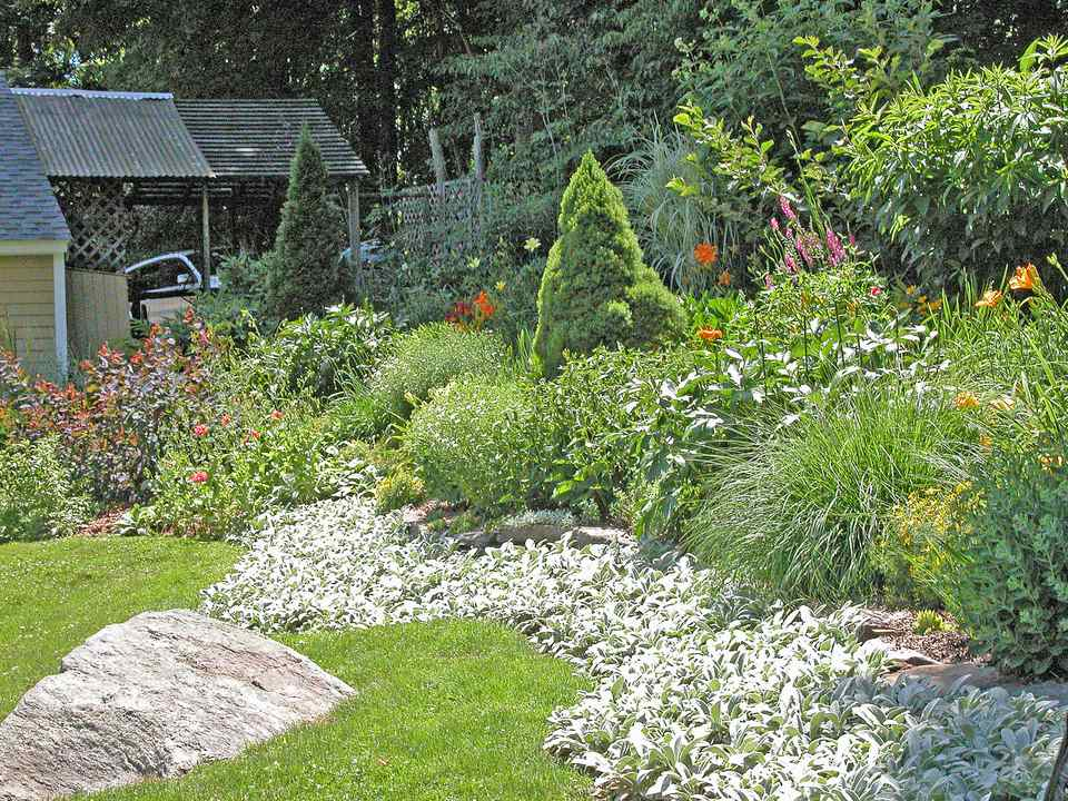 12 Hillside Landscaping Ideas to Maximize Your Yard on Downward Sloping Garden Ideas id=57411