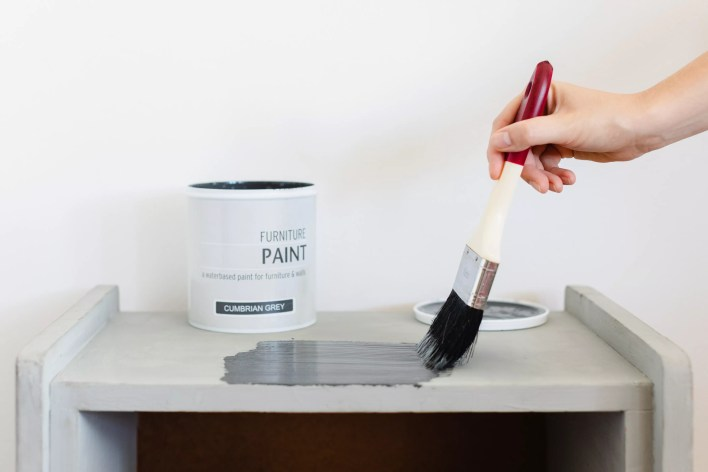 Waterborne acrylic enamel painted on shelf with brush