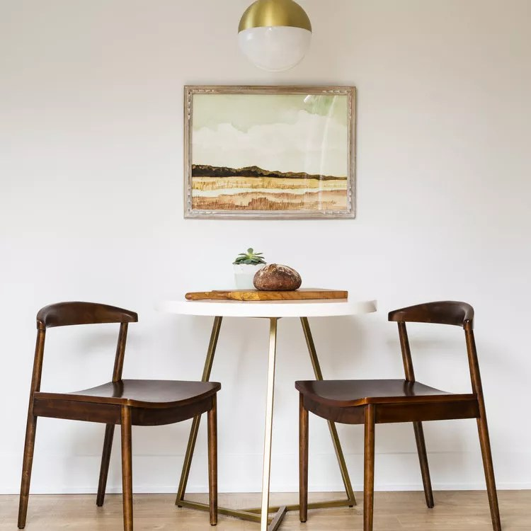 Gold dipped globe pendant lamp over table