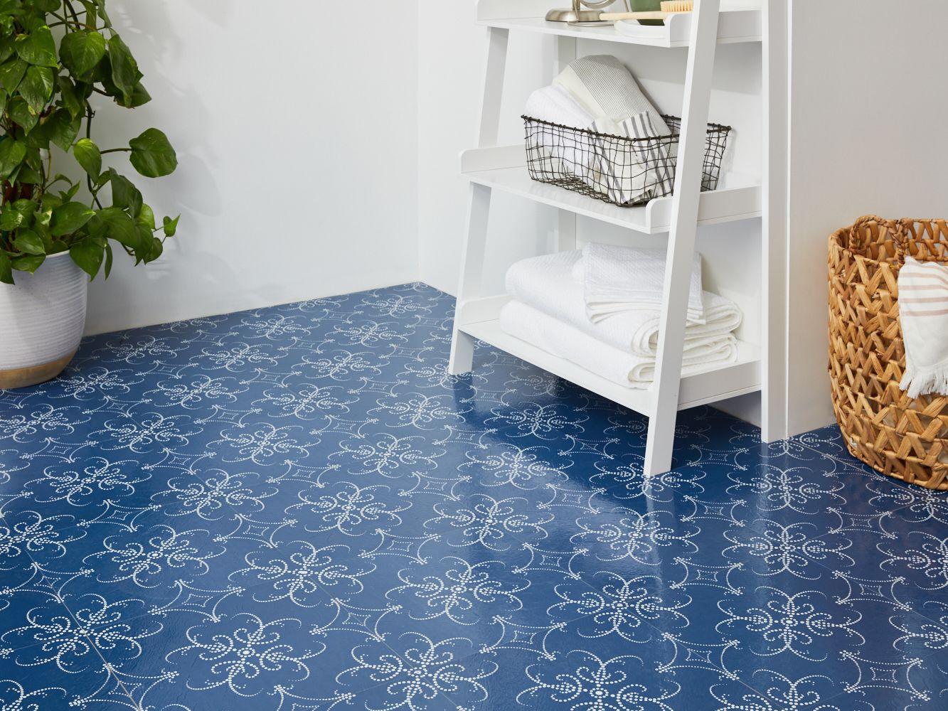 a bathroom with self adhesive floor tiles