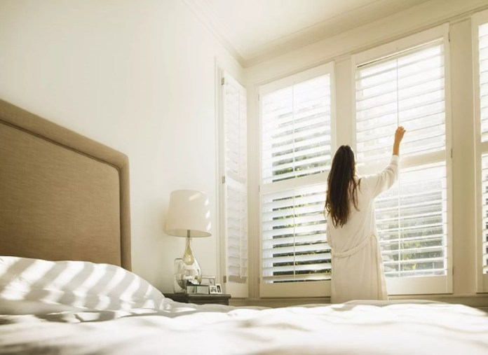 Window blinds in a neutral bedroom