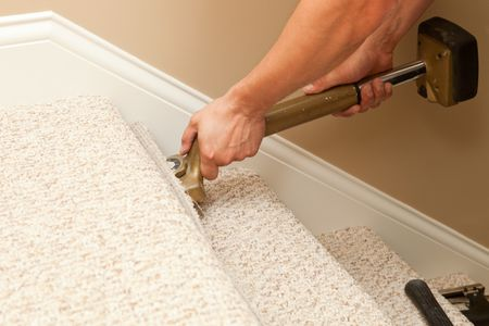 Stair Carpeting Installation Guide and Tips Installer Using Carpet Stretcher on Stairs