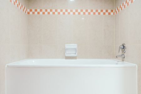 how to install adhesive tub or shower