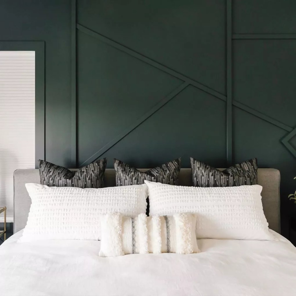 Bed made with green wall