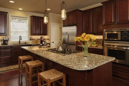 Top 10 Materials for Kitchen Countertops Custom kitchen with granite slab counter tops