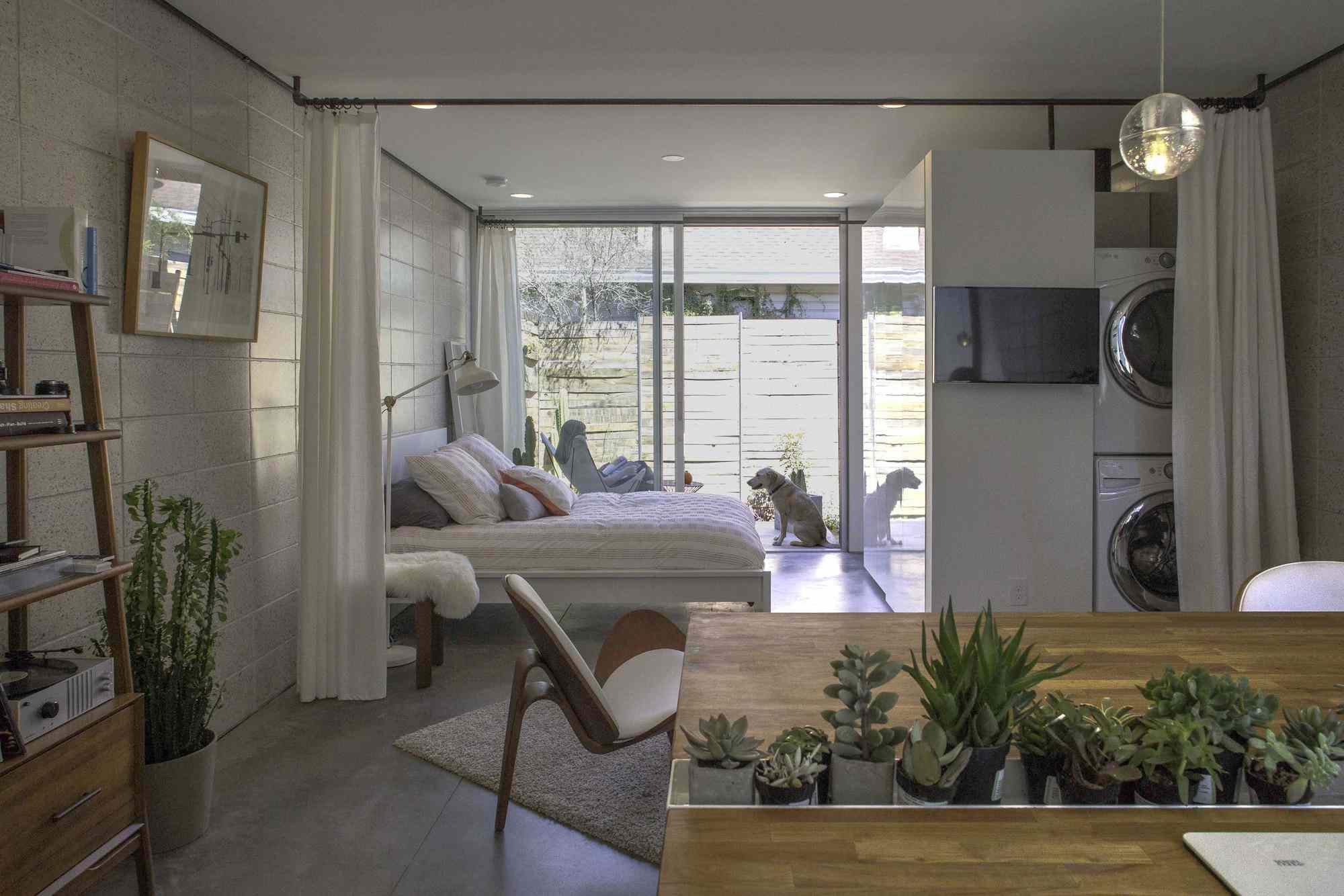 a bedroom in a studio apartment