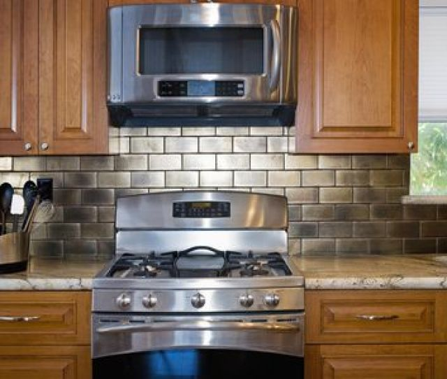 Microwave And Stove In Contemporary Kitchen