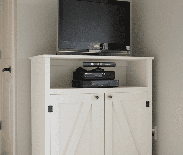 Picture Of A White Entertainment Center With A Tv