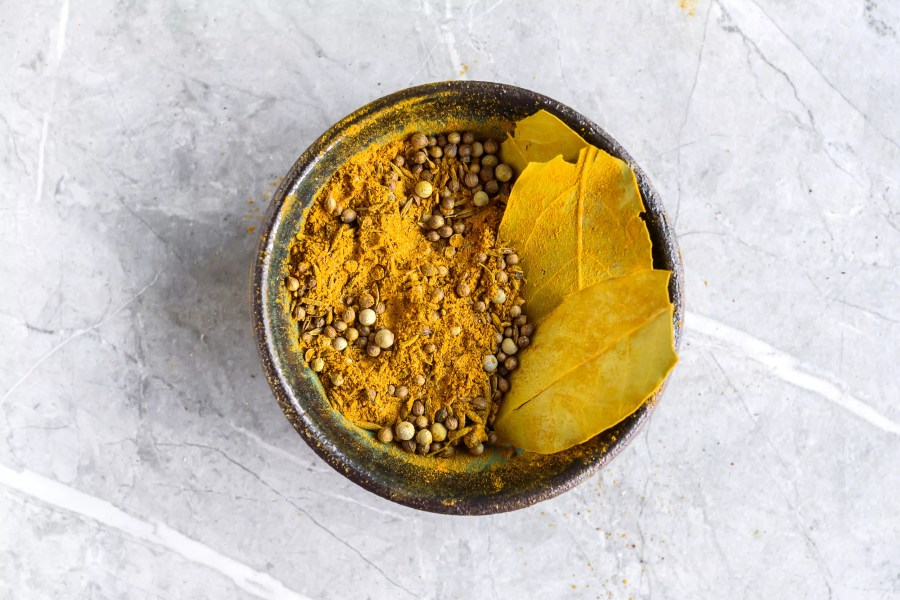 Thai Curry Powder spices in a grinder