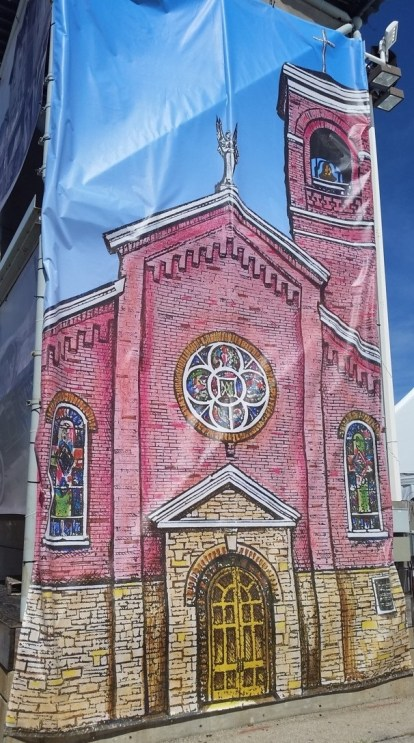 "A banner at Festa Italiana showing the ""Little Pink Church."" All photos by Joe Powell unless otherwise noted."