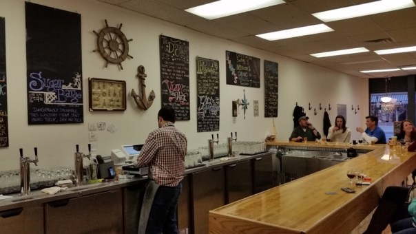 The bar is the focal point of the tap room.