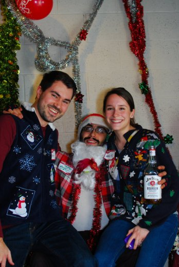 Us with Sketchy Santa in our Ugly Sweaters. Photo by Yelp. Featured photo by Joe Powell.