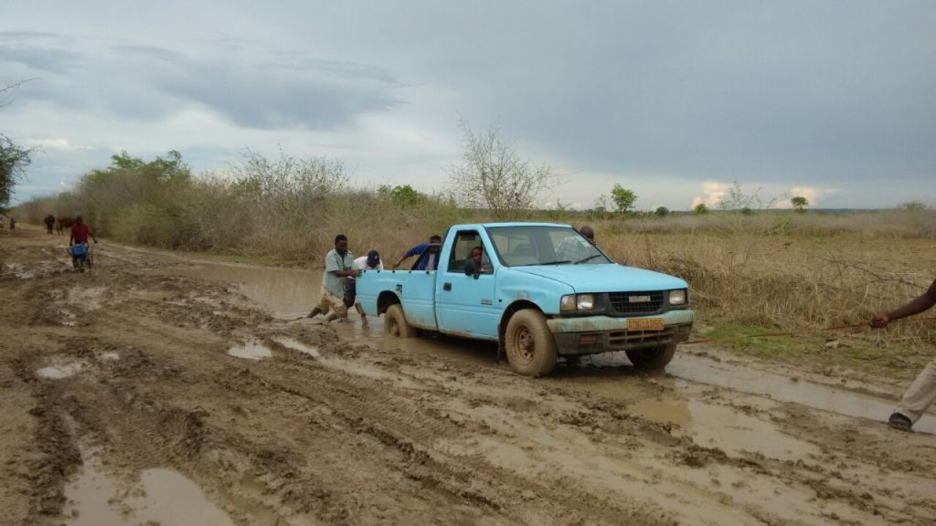 Passengers push a truck along the muddy Nembudziya-Mashame road recently... The poor road network has immensely contributed to the demise of the health delivery system in Gokwe North.