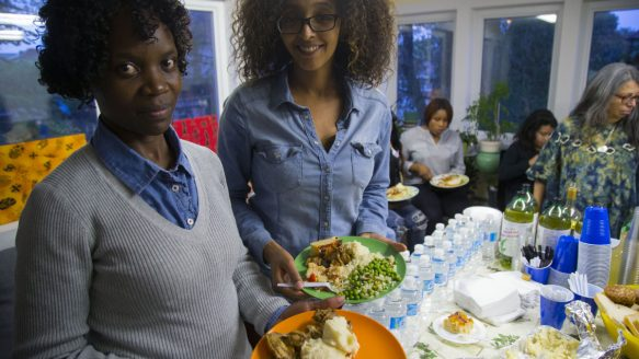 Beatrice Balinda, left and Haben Tesfai take part in Thanksgiving dinner at the FCJ Refugee Centre.