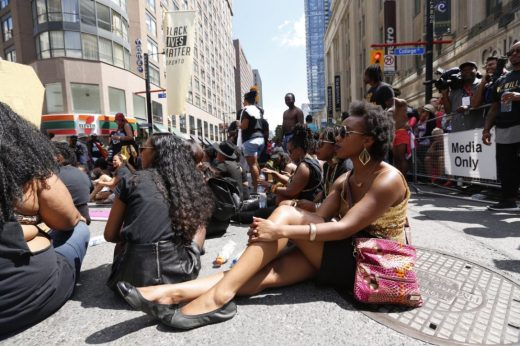 Black Lives Matter Toronto holds a sit-in during the Pride Parade.