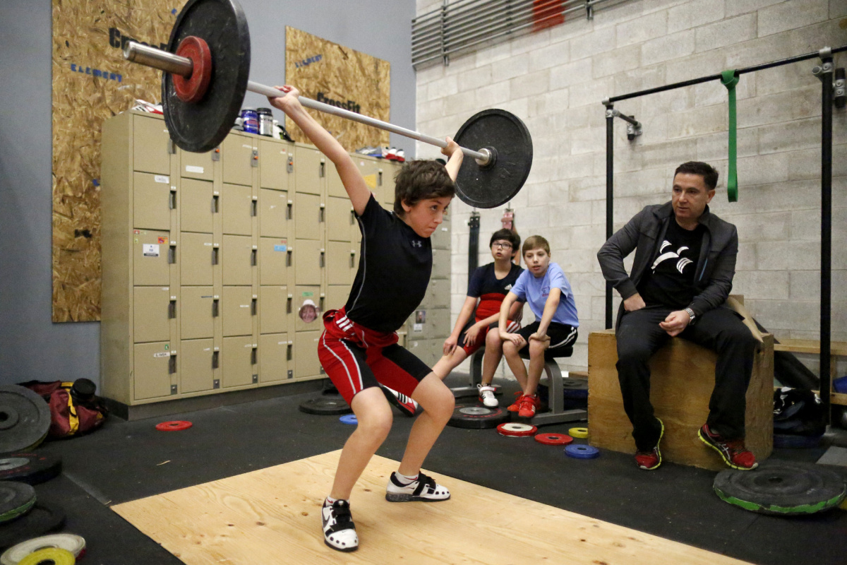 Young Weightlifters Combine Finesse Strength For Success