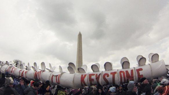 Demonstrators carry a replica of a pipeline during a march against the Keystone XL pipeline in Washington on Sunday.The TransCanada pipeline would link the oil sands of northern Alberta to refineries and ports in Texas.