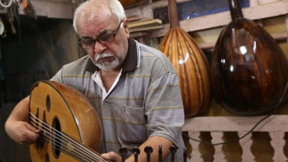 Mahmoud Abdulnabi plays an oud, an Arabic instrument related to the lute, at his workshop in Baghdad last month.