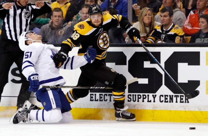 Boston's David Pastrnak sheds Leaf defenceman Jake Gardiner along the boards in Game 2, in which Pastrnak racked up six points.