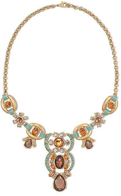 Paradise Cove Statement Necklace Your time to shine! Dazzle a room with the Paradise Cove Statement Necklace. Brushed goldtone this statement necklace features bright amber and turquoise colored stones.