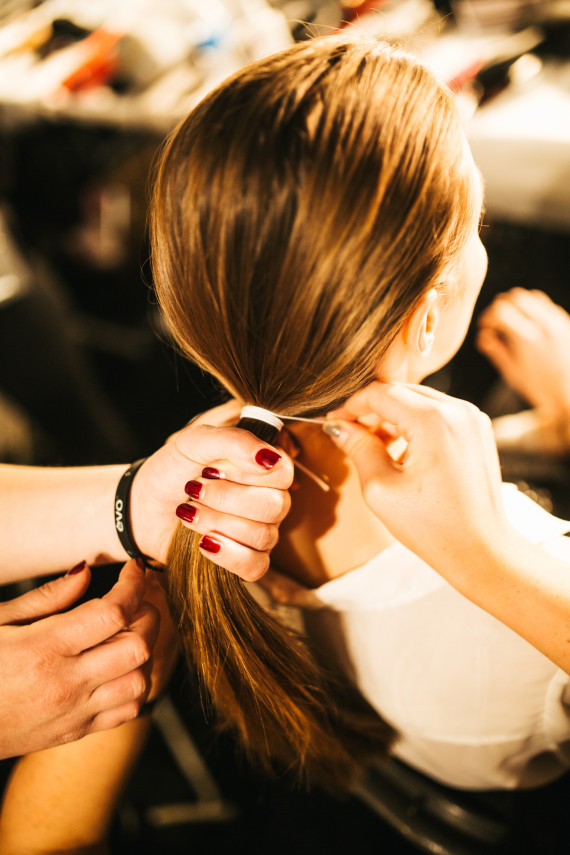 using a thin elastic or hat elastic and secure hair into a tight ponytail at the base of the hair.
