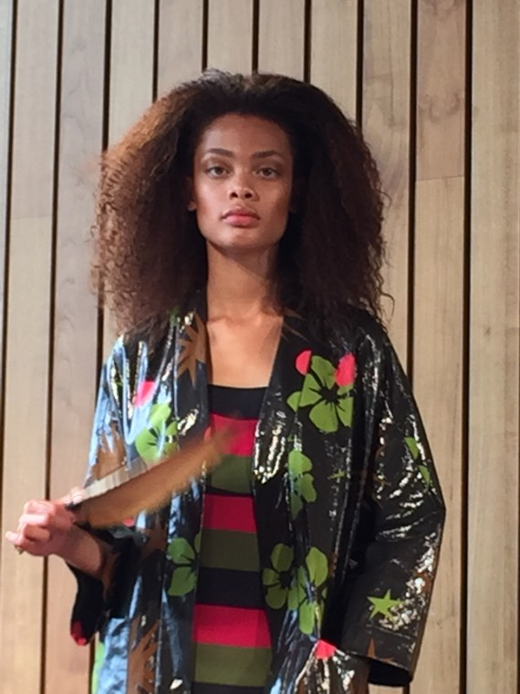 For evening glamour is introduced through flashes of ciclaomino, clashed with khaki, whilst tropical florals screenprinted through silk cotton adorn an evening coat.