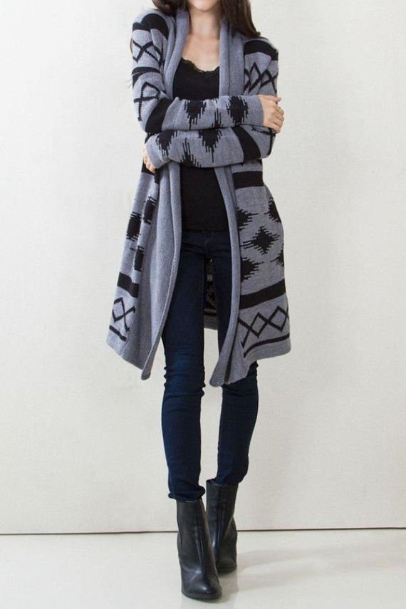Knee length grey and black aztec knit sweater cardigan with pockets on the side seam. A cozy necessity this fall. Pair with your favorite jeans, tee, and boots for a perfect fall outfit.