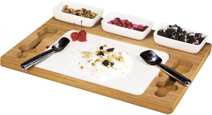 get creative with this ice cream set featuring two mixing paddles, three ceramic dishes and a marble slab perfect for creating a unique flavor with all your favorite mix-ins