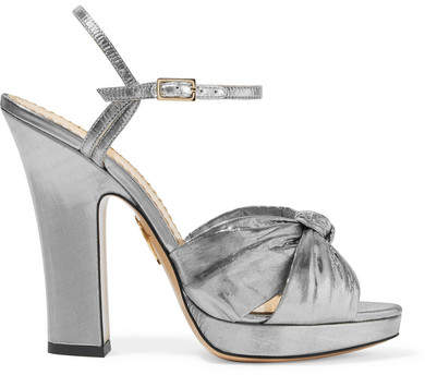Part of Charlotte Olympia's disco-inspired Resort '18 collection, these silver lamé sandals are named after Farrah Fawcett - a true icon of the era. They have a knotted footstrap and are set on a slight platform to balance the 125mm block heel. Continue the retro feel by wearing yours with flared jeans or a polka-dot dress.