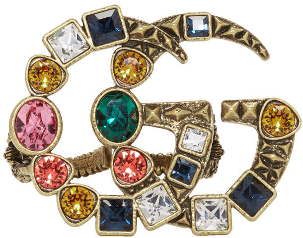 Multi-finger ring in antiqued gold-tone. Multicolor crystal accents throughout