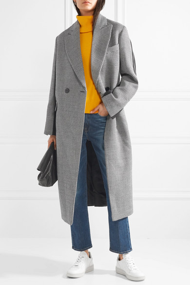 This double-breasted coat is made from wool-tweed with a panel of black wool-twill at the back, and finished with trailing silk-grosgrain trims. Wear it over a bright sweater to highlight the monochrome palette.