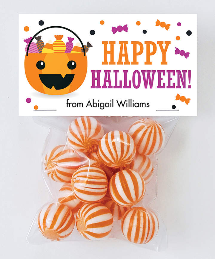 Loose candy and non-edible goodies are ready for trick-or-treaters in spill-proof bags sealed with playful personalized tags.
