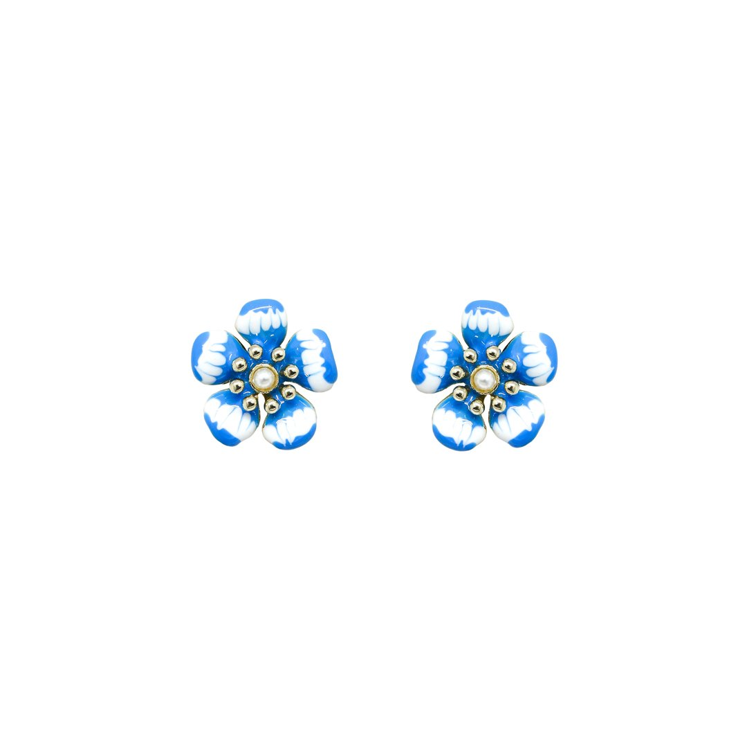 These delicate flower stud earrings feature a pearl and an artistic enamel layer. With a vibrant blue color and a feminine design, Iris Blue gold plated studs feel and look amazing. Wear these gold dipped stud earrings with a chiffon dress and a pair of summer sandals to get an inspirational look.