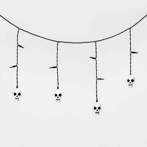These LED Incandescent Skull Halloween Icicle Lights from Hyde & EEK! BoutiqueTM are sure to bring the spooky vibes you're looking for. These Halloween-themed string lights come with light-up white skulls dropping down from a black cord, making for an easy addition to your spooky decor. Hang along the banister or drape around a door frame to complete your festive space