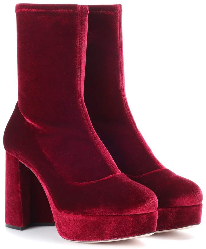 Miu Miu's ankle boots have been crafted in Italy from plush velvet and the ankle section is made with stretch for a fitted sock-like fit.