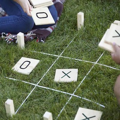 This Giant Tic-Tac-Toe game is loads of fun both indoors and outdoors. Use the stakes and rope to create game perimeters. Comes with a drawstring burlap bag for easy transport. Customize the tiles with your favorite paint or stain. Get the party started with Giant Tic-Tac-Toe!