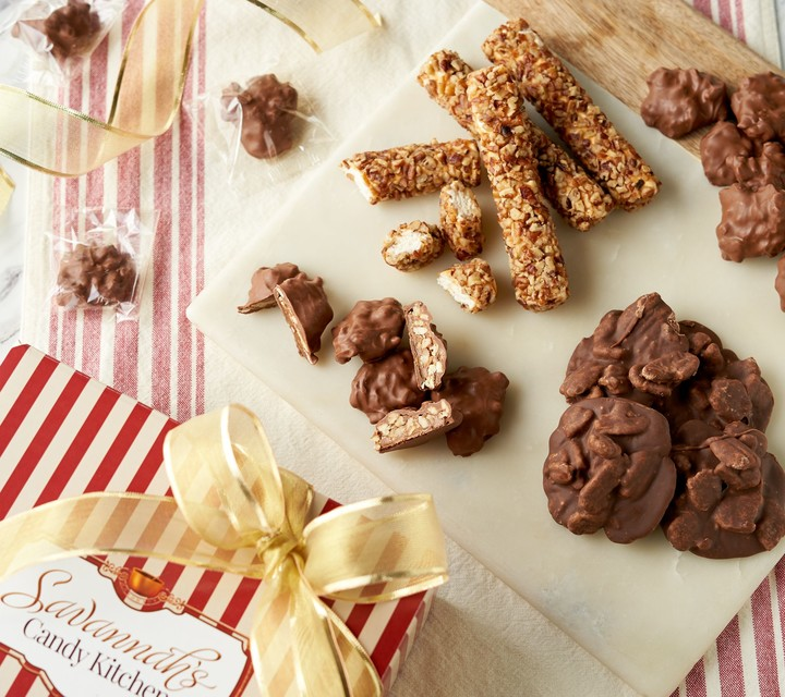 Stock up on sweet Southern favorites with this assortment of pecan log rolls, pralines, and chocolate turtles.