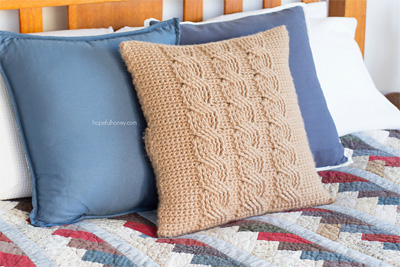 Cabled-Throw-Cushion-Cover- & 22 Free Crochet Pillow Patterns That Are Perfect for Decorating ... pillowsntoast.com
