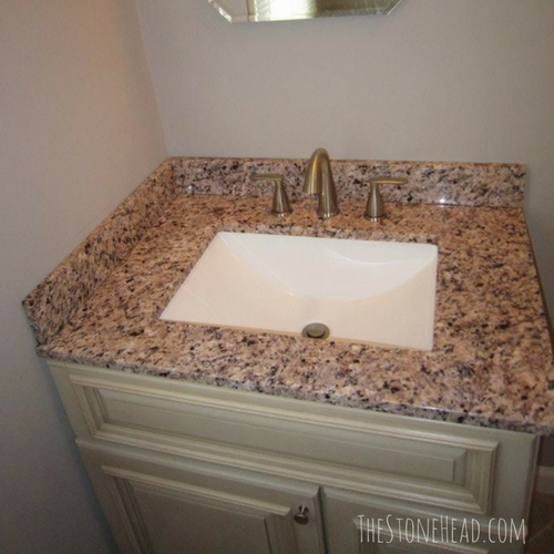 We're flipping houses for a living! Check out this granite top we put in the master bathroom remodel! Check out all the before and after pictures on my blog!