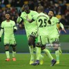 Yaya Toure (2nd L), Fernandinho (2nd R) and Gael Clichy (R) celebrate the final goal of Manchester City during the UEFA Champions League Round of 16 soccer match between Dynamo Kyiv and Manchester City at NSC Olimpiyskiy on February 24, 2016 in Kiev, Ukraine.
