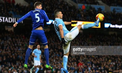 MANCHESTER, ENGLAND - JANUARY 27: Sergio Aguero of Manchester City controls the ball under pressure from John Stones of Everton during the Capital One Cup Semi Final, second leg match between Manchester City and Everton at the Etihad Stadium on January 27, 2016 in Manchester, England. (Photo by Alex Livesey/Getty Images)